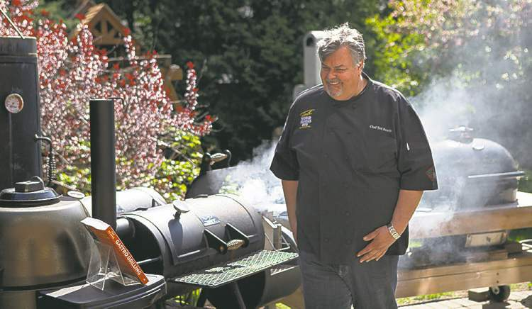 """Ted Reader, author of the recent book """"Gastro Grilling"""" fires up a charcoal grill in Toronto on Wednesday May 15, 2013. THE CANADIAN PRESS/Chris Young"""