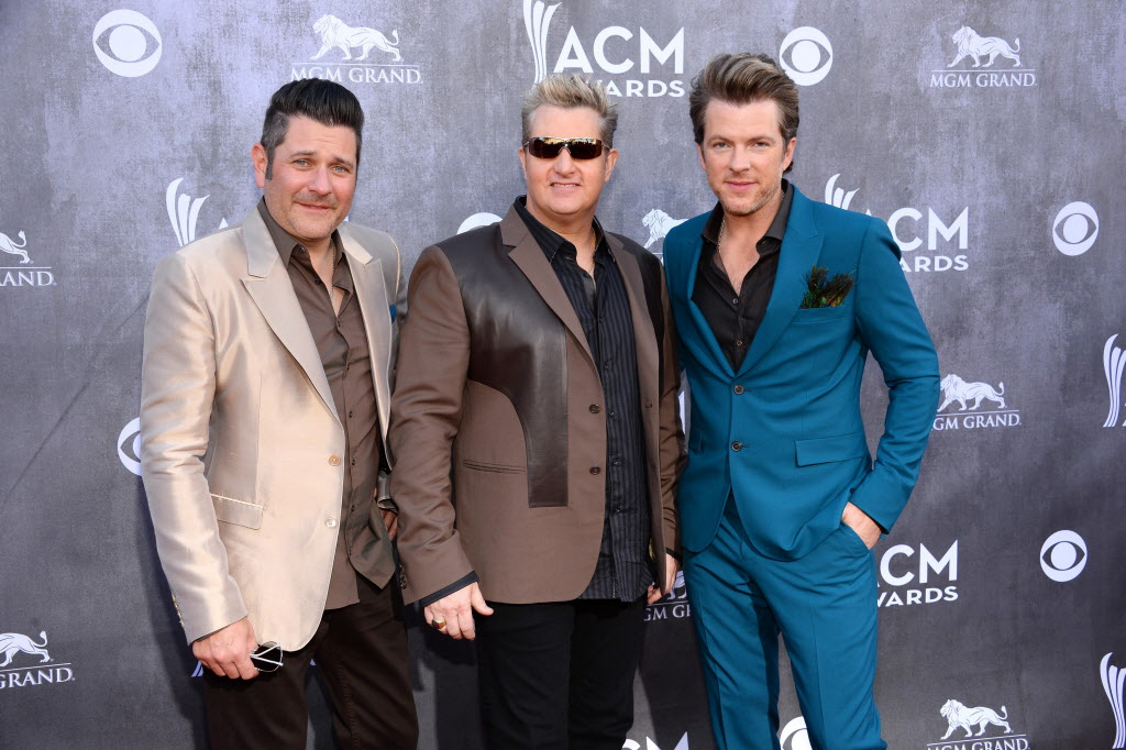 Jay DeMarcus, and from left, Gary LeVox and Joe Don Rooney, of the musical group Rascal Flatts, arrive at the 49th annual Academy of Country Music Awards.