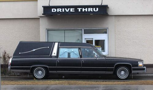 A hearse waits at the Kentucky Fried Chicken outlet drive through at Notre Dame Avenue and Sherbrook Street.  Tuesday, March 27, 2012    (JOE BRYKSA / WINNIPEG FREE PRESS)