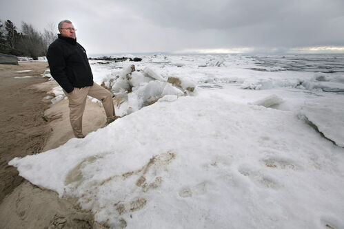 Rod Bollman, harbour master with the Victoria Beach Harbour Authority looks over the ice covered Lake Winnipeg.