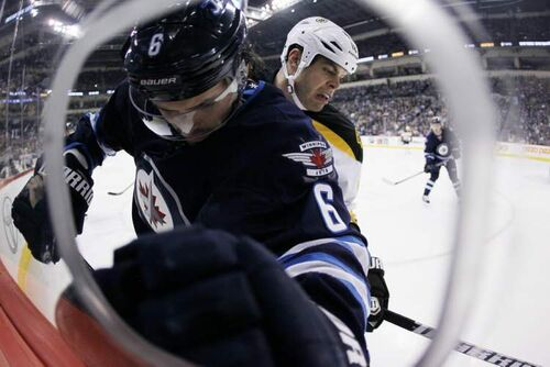 Ron Hainsey and Bruins' Nathan Horton fight for the puck during the first period.