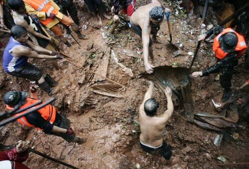 Filipino rescuers dig for survivors where four homes collapsed in a landslide incident in Quezon City, north of Manila, Philippines, on Tuesday Aug. 7, 2012. Relentless rains submerged half of the sprawling Philippine capital, triggered a landslide that killed eight people and sent emergency crews scrambling Tuesday to rescue and evacuate tens of thousands of residents.  AP Photo / Mike Alquinto