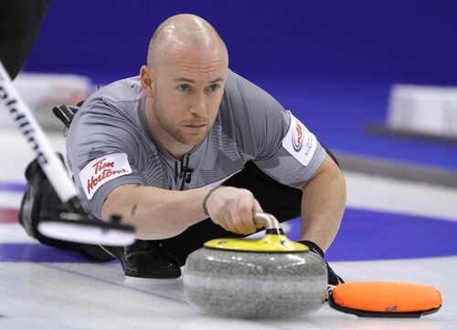 Third Ryan Fry of the Brad Jacobs rink throws a stone.