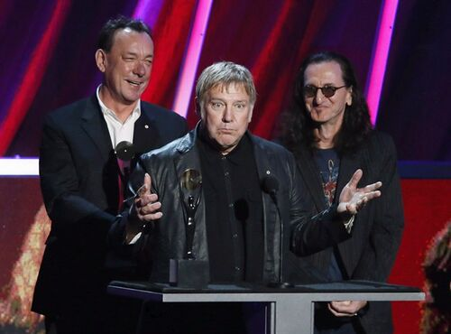 Alex Lifeson, centre, Neil Peart, left, and Geddy Lee, right, of Rush accept their band's induction into the Rock and Roll Hall of Fame on Thursday, April 18, 2013 in Los Angeles. The upcoming Rush tour is billed as a 40th anniversary celebration ??? but it could just as easily be advertised as a retirement party of sorts. No, the beloved Toronto power-prog band isn't going away, exactly, but they say this will be their last major tour. THE CANADIAN PRESS/Danny Moloshok/Invision/AP