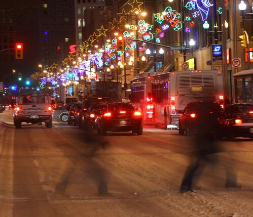 Holiday Lights - Holiday lights create a glow in downtown Winnipeg during early morning rush hour.  Friday, November 30, 2012    (JOE BRYKSA / WINNIPEG FREE PRESS)