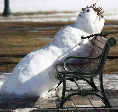 Help Me I'm Melllllting - A snowman melts on a bench on the grounds of the Manitoba Legislature in Winnipeg.  Sunday, March 11, 2012 (JOE BRYKSA / WINNIPEG FREE PRESS)