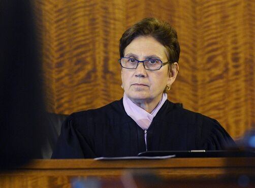 Judge E. Susan Garsh listens during an evidentiary hearing for former New England Patriots player Aaron Hernandez at Bristol County Superior Court, Thursday, Oct. 2, 2014, in Fall River, Mass. Hernandez, 24, has pleaded not guilty to first-degree murder in the 2013 shooting death of Odin Lloyd, a Boston semi-professional football player who was dating the sister of Hernandez's fiancee. (AP Photo/CJ Gunther, Pool)