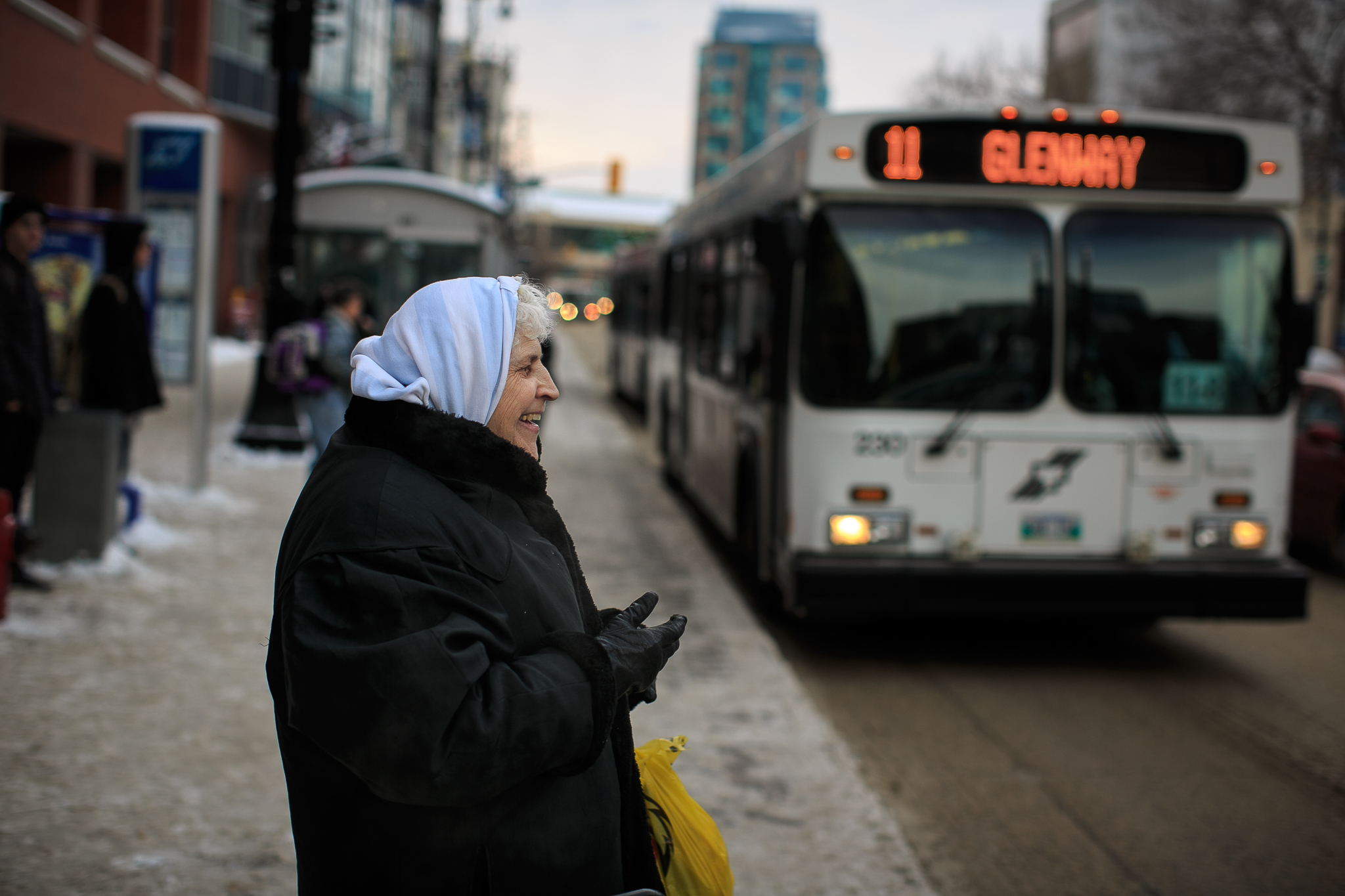 Polly about to catch her bus on Portage Avenue. Day 42. (MELISSA TAIT / WINNIPEG FREE PRESS)