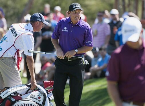 Phil Mickelson walks off the 15th green during the third round of the Valero Texas Open golf tournament, Saturday, March 28, 2015, in San Antonio. (AP Photo/Darren Abate)