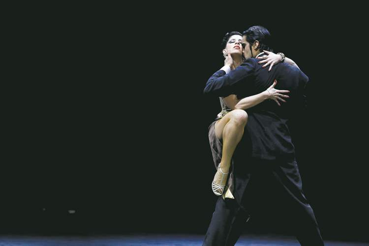 Argentina's Nahuel Tortosa, back to camera, and Barbara Ferreyra compete during the 2012 Tango Dance World Cup stage finals in Buenos Aires.