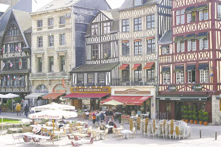 On Rouen's lively market square, visitors can eat at a sidewalk bistro just feet from the spot where Joan of Arc met her fiery fate in 1431.