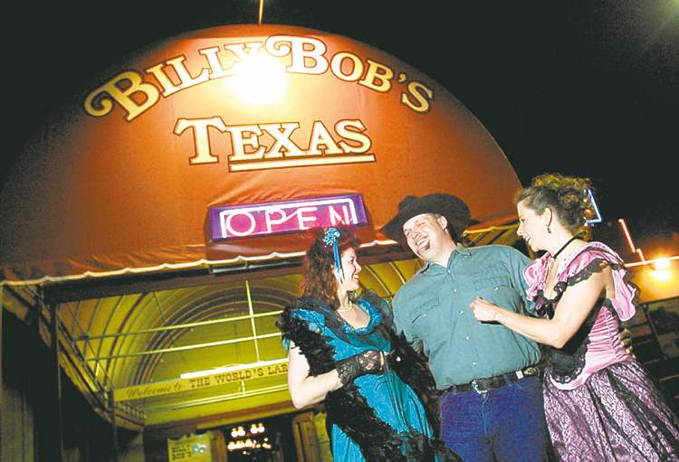 Billy Bob's Texas, the world's largest honky-tonk bar, has an indoor rodeo, stages for live act, copious dance floors and a restaurant where beef brisket is the star.