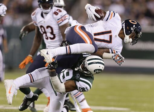 Chicago Bears wide receiver Alshon Jeffery (17) is tackled by New York Jets free safety Antonio Allen (39) during the fourth quarter of an NFL football game, Monday, Sept. 22, 2014, in East Rutherford, N.J. (AP Photo/Julio Cortez)