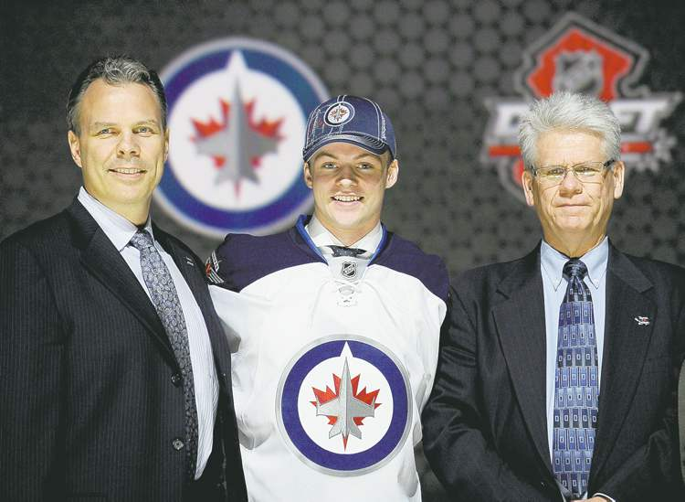 bill kostroun / the associated pressKevin Cheveldayoff (left, with head scout Marcel Comeau, right) can�t stop gushing about his latest draft pick, Prince Albert Raiders star Josh Morrissey.
