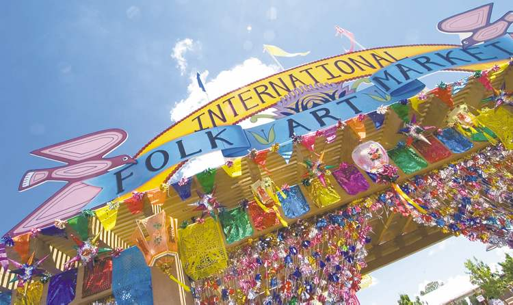 Colorful entrance sign for Santa Fe's International Folk Art Market which celebrates its 10th anniversary July 12-14.