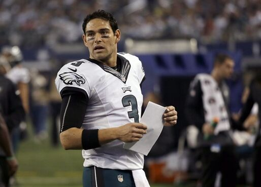 Philadelphia Eagles quarterback Mark Sanchez (3) stands on the sideline during the second half of an NFL football game against the Dallas Cowboys, Thursday, Nov. 27, 2014, in Arlington, Texas. (AP Photo/Tim Sharp)