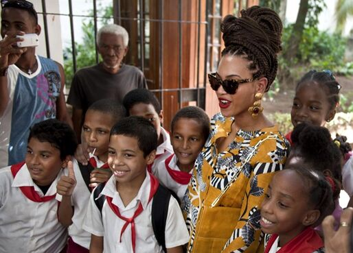 FILE - In this April 4, 2013, file photo, U.S. singer Beyonce poses for photos with school children as she tours Old Havana, Cuba. The Treasury Department's Inspector General has found this Thursday Aug. 21, 2014, that Jay-Z and Beyonce's fifth-anniversary trip to Cuba last year was legal under U.S. rules allowing educational travel to the island. (AP Photo/Ramon Espinosa, File)