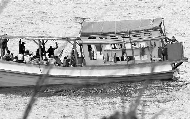 A fishing boat carrying Vietnamese asylum-seekers nears the shore of Australia's Christmas Island in April 2013.