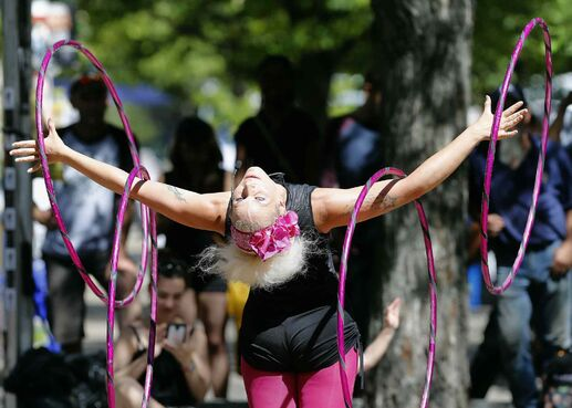 Lisa Lottie performs her hoop program at the Fringe Festival's free stage at The Cuba, Friday. An estimated 95,000 people attended free shows in in Old Market Square during the 12-day event.