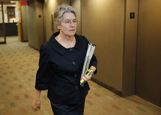 Sheila Block, lawyer for embattled Manitoba Justice Lori Douglas, an associate chief justice of Manitoba, enters a preliminary hearing room in Winnipeg, Monday. Douglas has avoided a disciplinary hearing over nude photos by agreeing to retire.