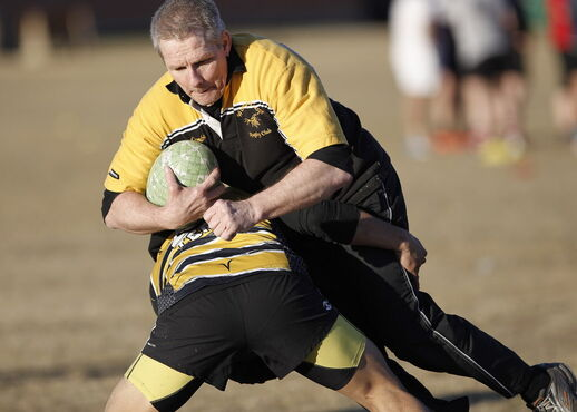 Flanker Ron Enberg takes a hit in practice on Monday.