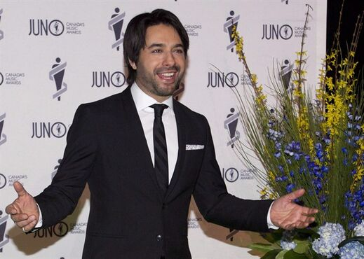 Jian Ghomeshi arrives on the green carpet for the Juno Gala in Winnipeg on Saturday, March 29, 2014. Police in Toronto have opened a criminal investigation into former star radio host Jian Ghomeshi. THE CANADIAN PRESS/John Woods