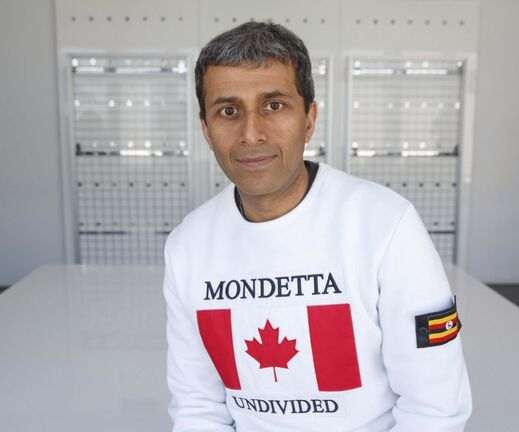 MIKE DEAL / WINNIPEG FREE PRESSAsh Modha at the Mondetta offices in Winnipeg. Mondetta started 32 1/2 years ago by three teenagers, is relaunching its original Mondetta design — white sweat shirt with flag on the front — at New York Fashion Week on the weekend, in a popup inside a Soho coffee house. However, the flag shirts can now have a patch of a second country of origin. For example, Ash's nephews are of African descent and have a Canadian flag on front with a Uganda patch on the shoulder. 180906 - Thursday, September 06, 2018.</p>