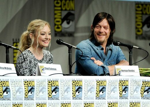 Emily Kinney, left, and Norman Reedus attend