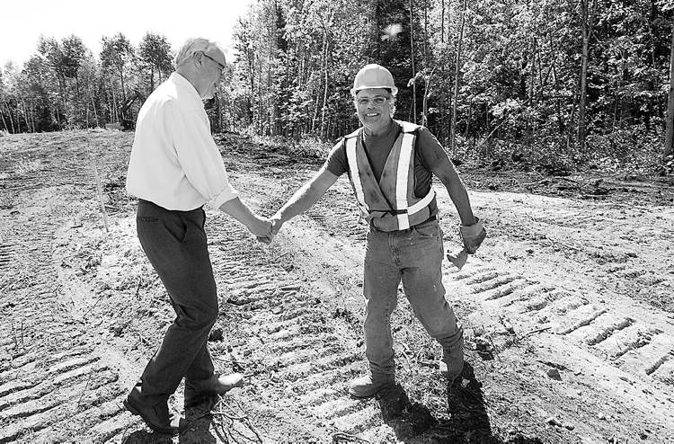 Manitoba Premier Greg Selinger meets construction worker Mike Byzuk of Don Sikora Contarcting Ltd at the unnamed Tim Horton Youth Leadership Camp to be built on Sylvia Lake on the Winnipeg River system-See Bruce Owen story- August 13, 2013   (JOE BRYKSA / WINNIPEG FREE PRESS)