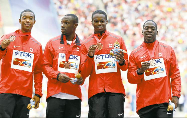 Canada's 4x100-meter men's relay team shows off their bronze medal won at the World Athletics Championships.