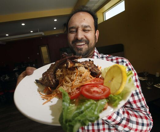 PHIL HOSSACK / WINNIPEG FREE PRESS</p><p>Barbeque Hut — Pakistani Grill owner Jehangir Khan shows off his pulao lamb chops.</p>