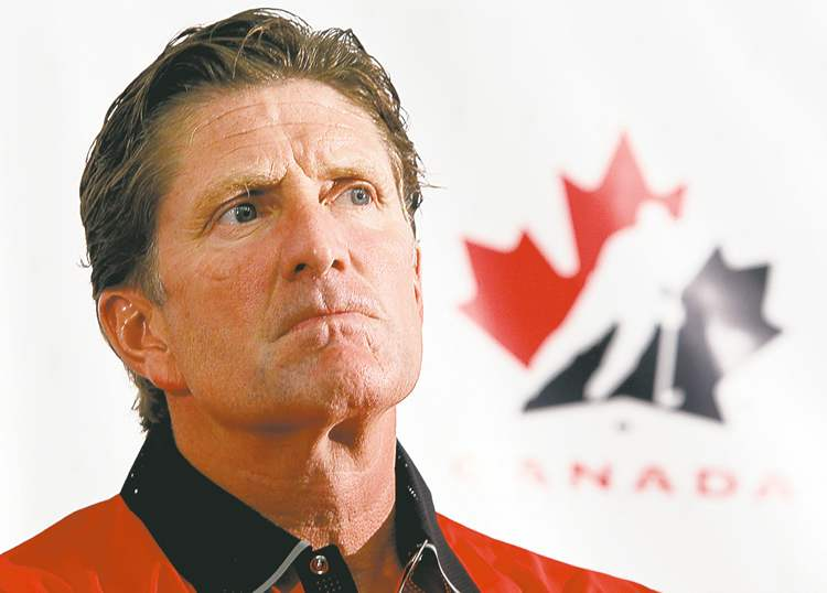 Team Canada head coach Mike Babcock speaks to reporters at the team's orientation camp Sunday.