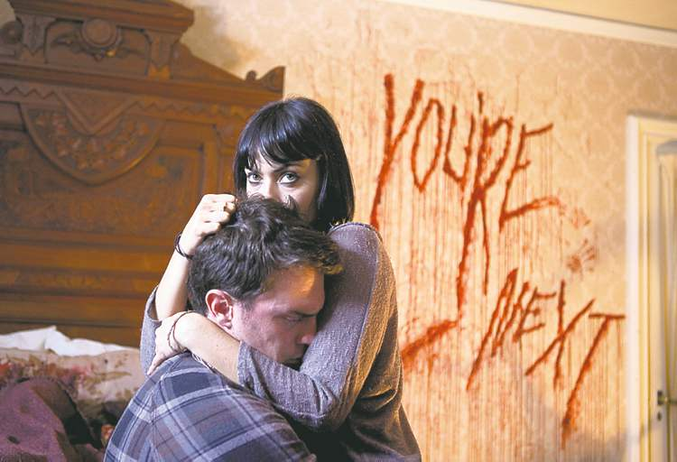 Nick Tucci and Wendy Glenn star in the thriller You're Next.