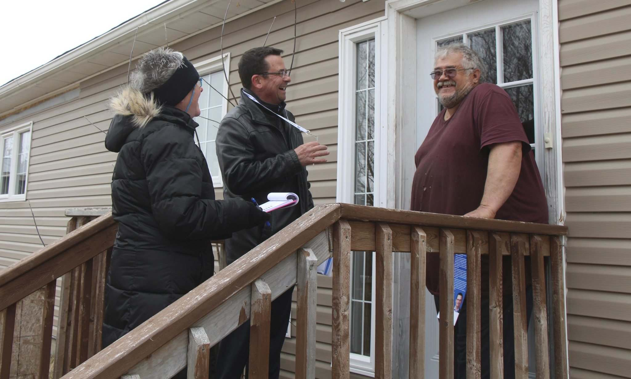 Gimli PC candidate Jeff Wharton (centre) and his wife Mickey speak to undecided voter Frank Harder while canvassing in Riverton, Man. on Friday, April 1, 2016.</p></p>