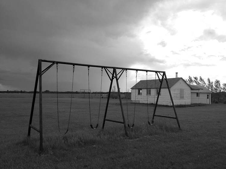 A swing set stands unused on an old-order Mennonite community in Manitoba.