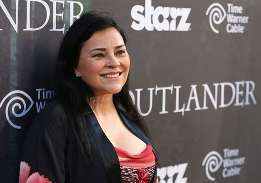 Diana Gabaldon arrives at the premiere for the STARZ original series