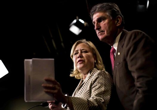 Sens. Mary Landrieu of Louisiana and Joe Manchin of West Virginia meet with reporters Tuesday in Washington after a bill to compel construction of the Keystone XL pipeline failed to clear the Senate.
