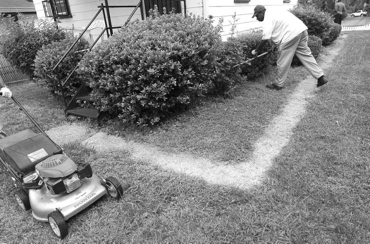 A man does yardwork in Washington in this Aug. 20 file photo.