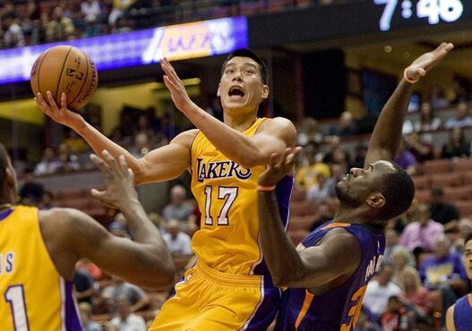 Lakers guard Jeremy Lin muscles his way around Phoenix forward Earl Barron to put up a shot during Tuesday's pre-season game Oct. 21, 2014. (AP Photo/The Orange County Register, Paul Rodriguez)