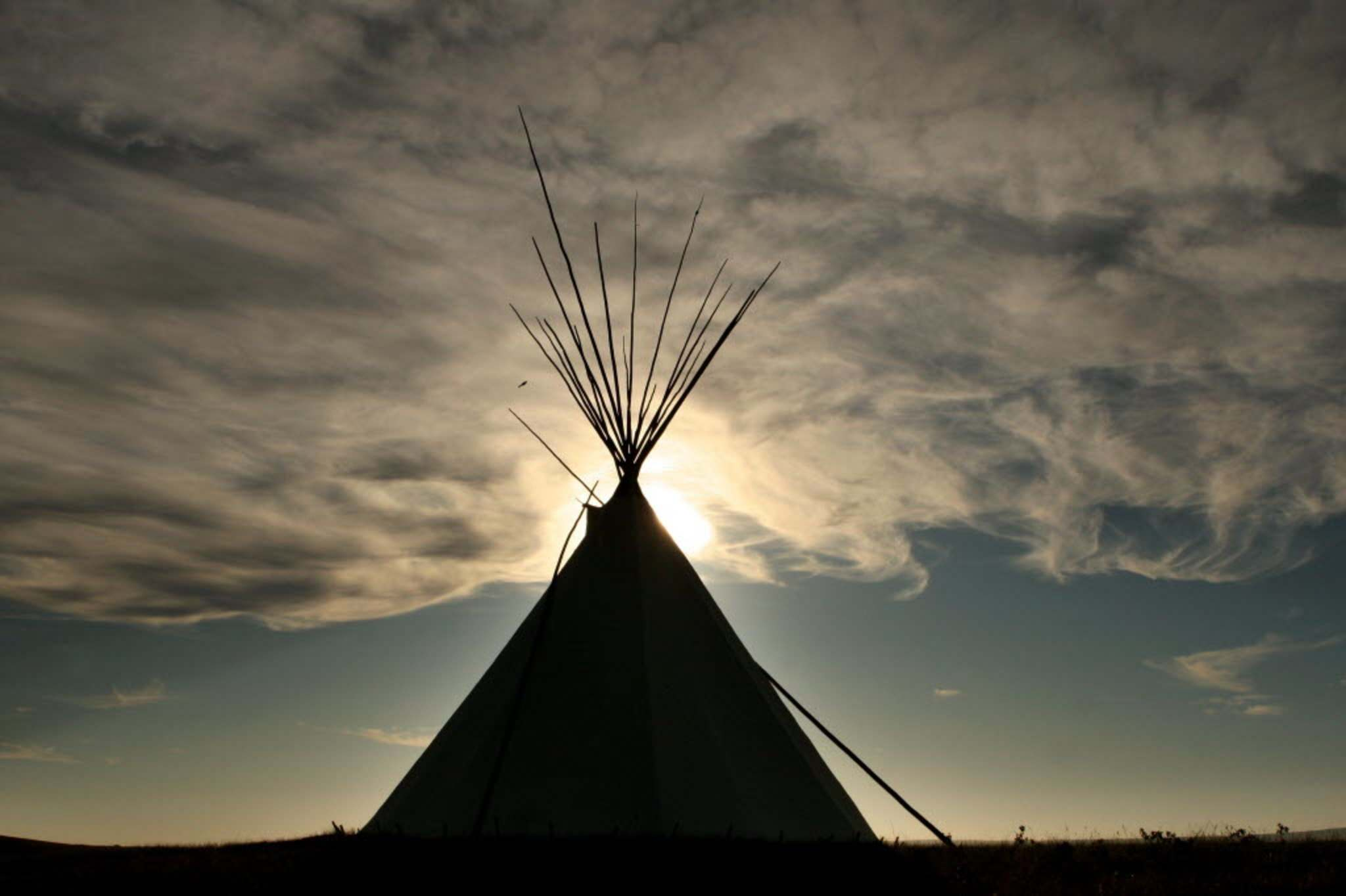 Wispy clouds form above a teepee at Blackfoot Crossing Historical Park on the Siksika Nation Reserve in Alberta in this October 2, 2009 file photo. (Leah Hennel/Calgary Herald) </p>