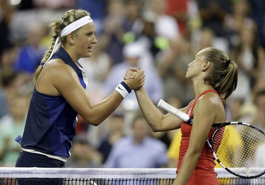Victoria Azarenka, of Belarus, is congratulated by Aleksandra Krunic, of Serbia, after Azarenka defeated Krunic in the fourth round of the 2014 U.S. Open tennis tournament Monday, Sept. 1, 2014, in New York. (AP Photo/Darron Cummings)