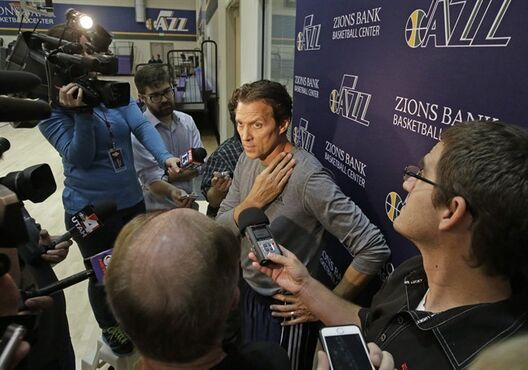 Utah Jazz coach Quin Snyder speaks with reporters following basketball practice Thursday, Oct. 23, 2014, in Salt Lake City. When Utah opens the season Wednesday, it will be the first time since 1988 that neither Jerry Sloan nor Tyrone Corbin--who played for Sloan--will be in charge on a Jazz sideline. (AP Photo/Rick Bowmer)