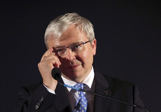 In this Friday, Sept. 6, 2013 file photo, Australian Prime Minister Kevin Rudd adjusts his glasses during a speech at a pre-election rally in Mt. Druitt, Australia. Rudd, the head of a new international commission wants John Baird, Canada's tough-talking foreign affairs minister, to help him reform the United Nations World Health Organization because it responded too slowly to the Ebola crisis. THE CANADIAN PRESS/AP/Rob Griffith