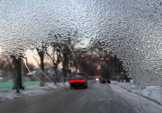 Cars in Winnipeg left outside in Sunday's freezing rain will need some time to warm up this morning.