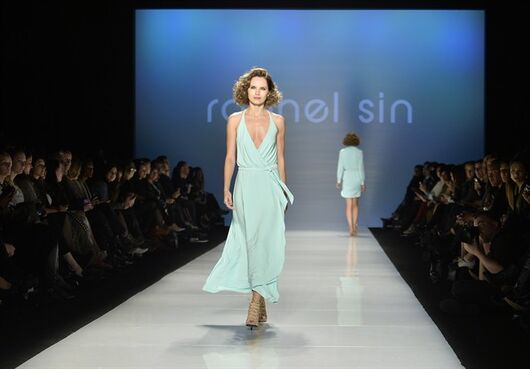 A model walks the runway wearing the collection of Rachel Sin during Toronto Fashion Week in Toronto on Wednesday, October 22, 2014. THE CANADIAN PRESS/Nathan Denette