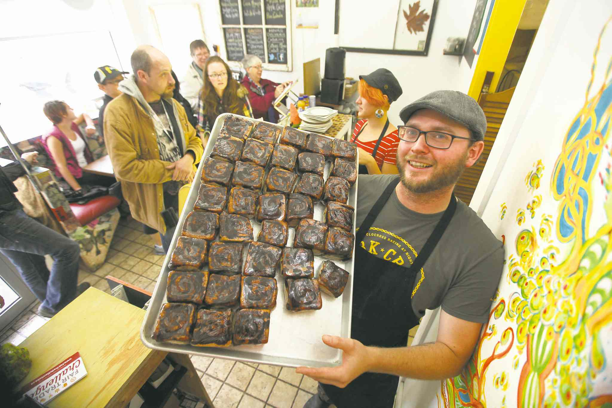 Ruth Bonneville / Winnipeg Free PressJon McPhail of Jonnies Sticky Buns shows his wares during a �carrotmob� celebration Saturday afternoon.
