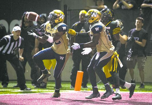 Winnipeg�s Nic Grigsby hauls in the game- tying touchdown catch with no time left on the clock Thursday night in Hamilton.