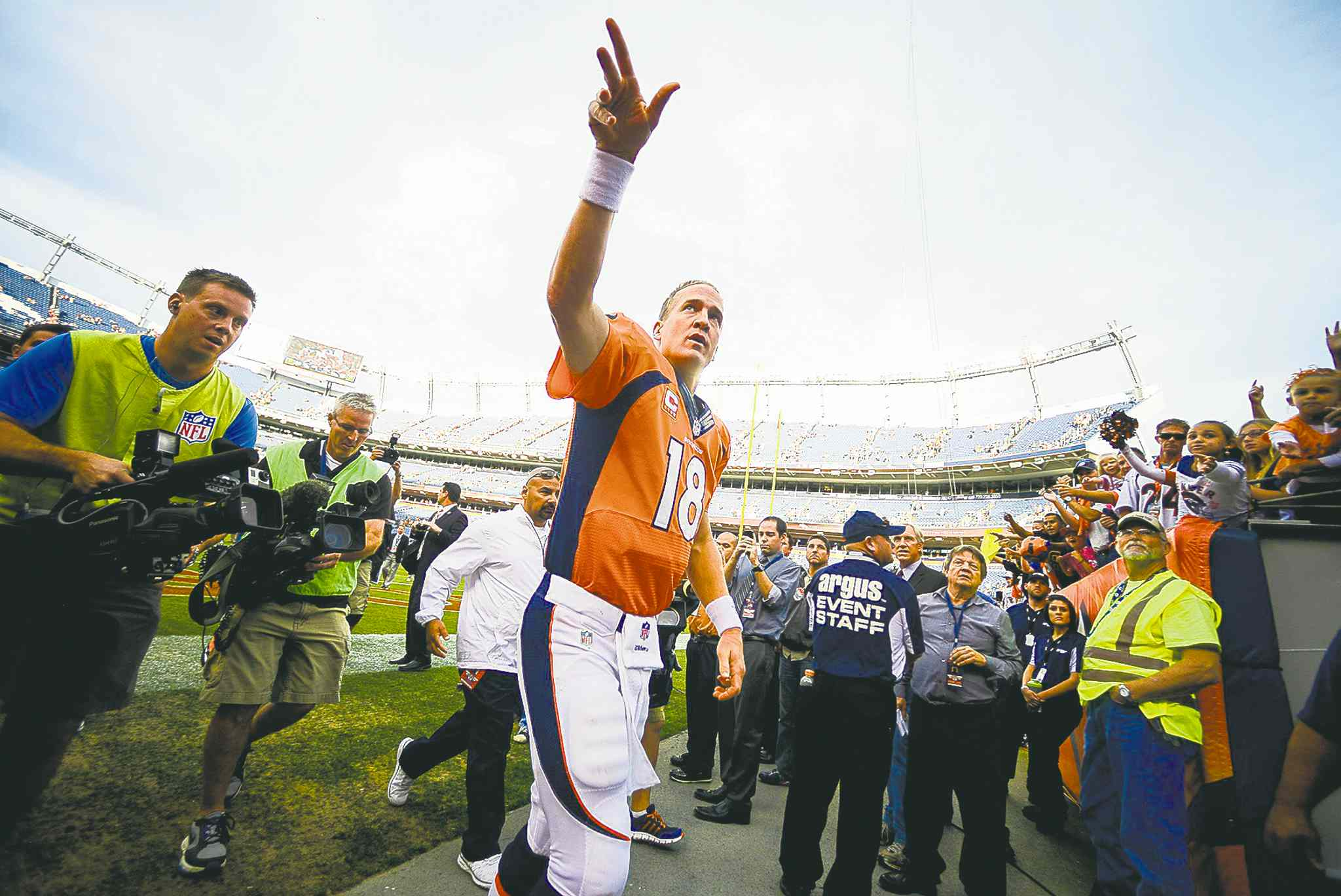 Denver Broncos quarterback Peyton Manning celebrates with fans after the Broncos crushed the Philadelphia Eagles 52-20 on Sunday.