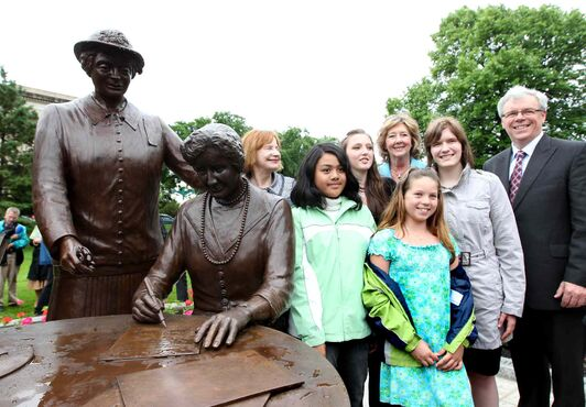 Premier Selinger poses with Janice Filmon (centre, background) and others at the Famous Five statue in 2010. Such a publicity opportunity now might be an offence during election period.