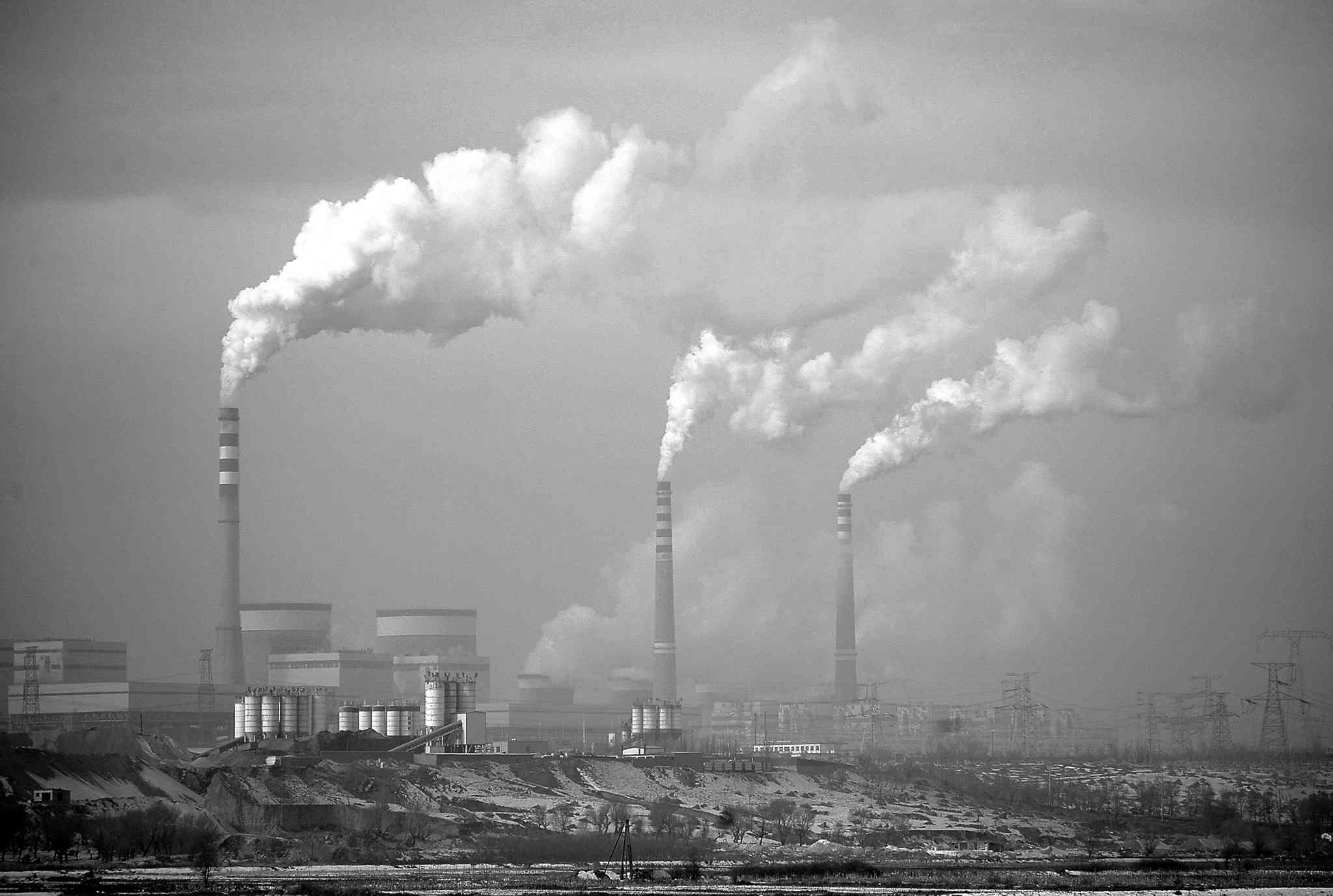 Carbon dioxide-producing smoke billows from chimneys of a coal-fired power plant in Dadong, China, in 2009.